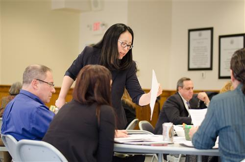 Assistant Superintendent of Curriculum Susan Yom Leads Group In Discussion
