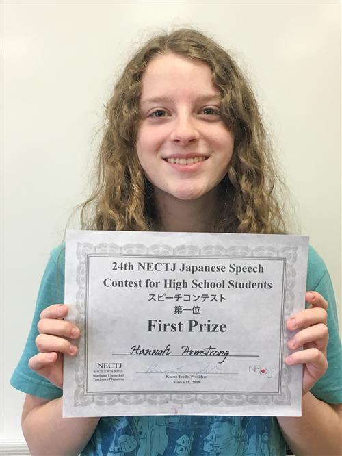 Hannah Armstrong Holding Her Contest Certificate